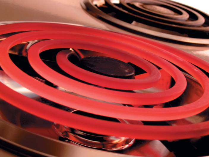 High current causes a stove heating element burner to glow red.